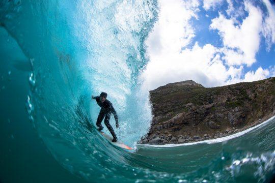 surfer on wave in a barrel